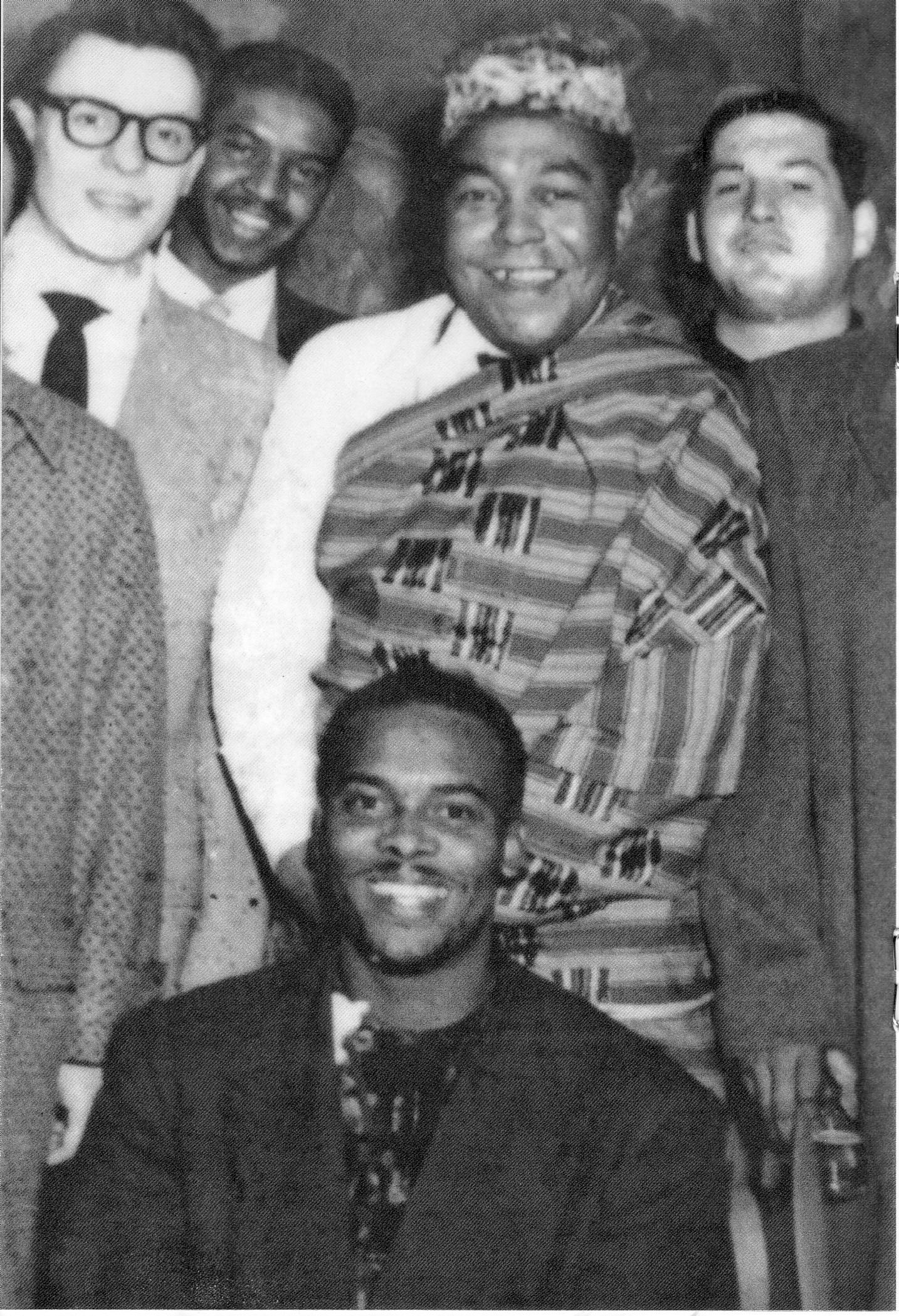 Charlie Parker in Chicago standing behind Guy Warren, wearing Warren's African Kente Cloth